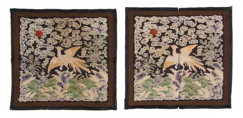 A Pair of Chinese Civil Official Rank Badges, depicting a golden pheasant for an official of the second rank, the bird depicted alighting on a rock emerging from crashing waves beneath a sky of ruyi clouds and a red sun. Leslie Hindman Auctioneers