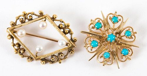 A Pair of Gold Scroll Brooches
