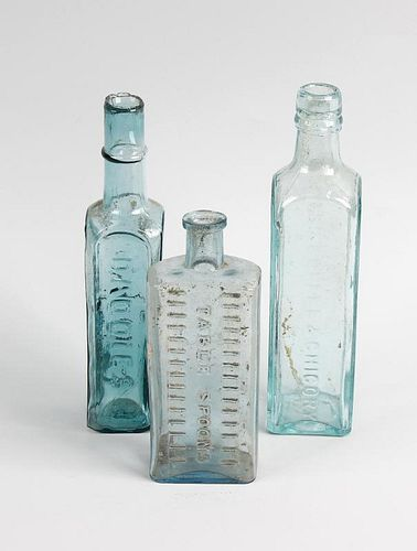 Two boxes containing a large collection of assorted glass bottles Principally antique condiment bott