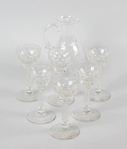 A glass sherry jug plus six glasses. The jug of pear form raised upon circular footed base, and deco
