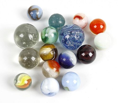 A case containing almost 300 marbles. To include onion skins, swirls, cats eyes and plain examples,