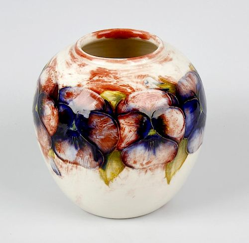 An unusual Walter Moorcroft 'Pansy' pattern vase Circa 1950, of ovoid form, with tube-lined decorati