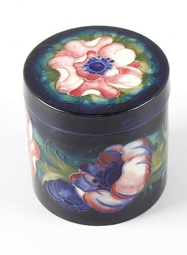 A Moorcroft pottery Anemone pattern jar and cover Of cylindrical form, the flat circular cover and t