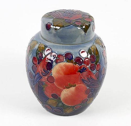 A Moorcroft pottery jar and cover, the ovoid body having blue/green glaze ground decorated with frui
