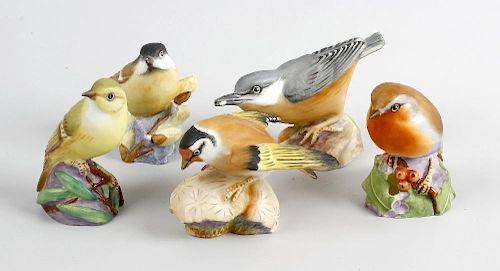 Five Royal Worcester bone china models of birds, comprising 'Robin', 'Wood Warbler', 'Goldfinch', 'M