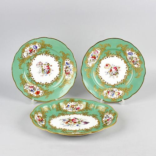 Four pieces of early 19th century Coalport-style porcelain. Comprising two serving plates of oval fo