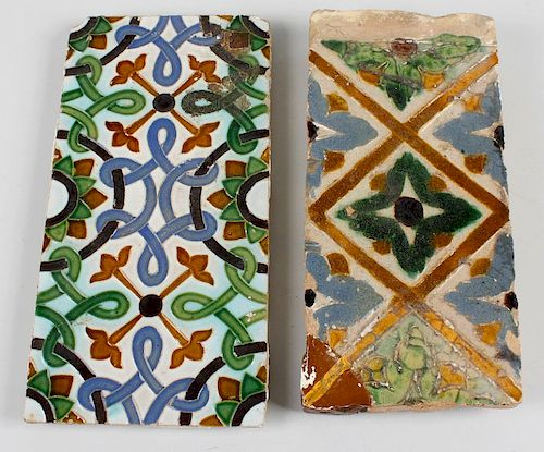 Two terracotta tiles, possibly 17th century, the first with stylised interlocking pattern with folia