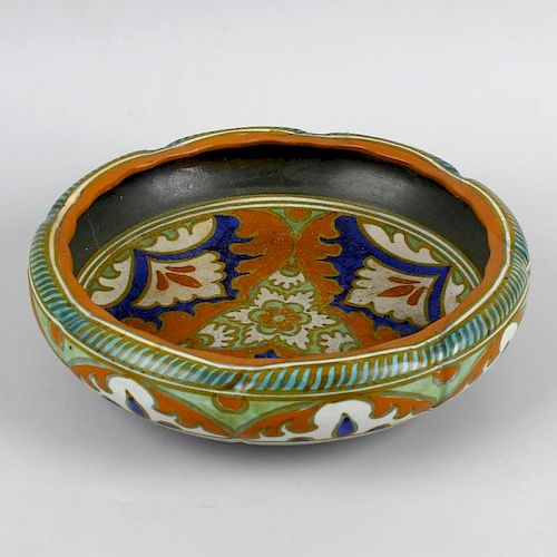 A Gouda pottery bowl. Of slightly lobed form decorated in orange, blue and cream glaze, the whole ra