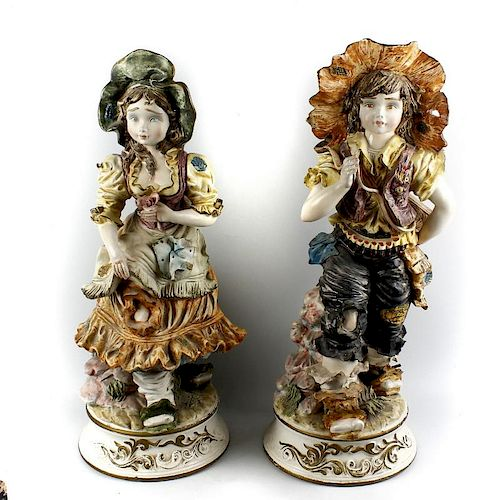 A large pair of Capodimonte figures Modelled as a boy and girl, he with rifle slung across his back,
