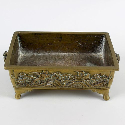A Japanese bronze bonsai planter. Of rectangular two-handled trough form cast with fish (perhaps koi