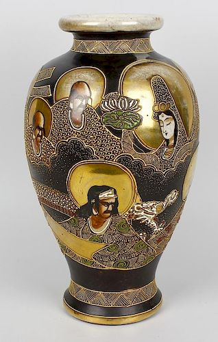 A Japanese Satsuma vase. Taisho period c. 1930, of baluster form with tube-lined decoration of deiti