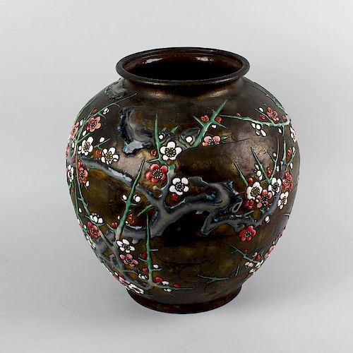 A large Japanese enamel on copper vase, of globular form, enamelled in relief with blossoming trees,