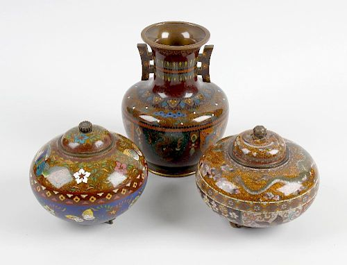 A group of cloisonne wares. Comprising a pair of pots and covers of bulbous form raised upon three s