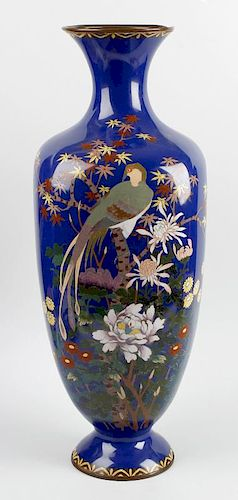A good large Japanese Meiji period cloisonne vase. The squared body with blue ground, decorated a st