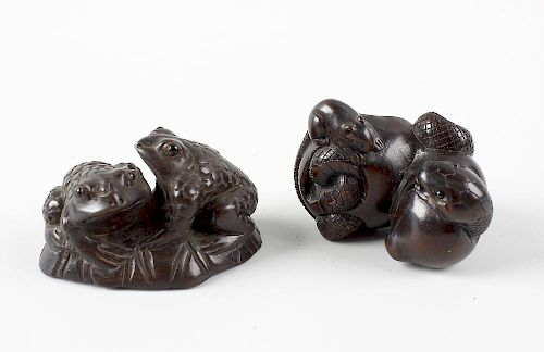 Two Japanese hardwood netsuke. The first modelled with two toads on a lily pad, 1.75, (4.75 cm) long