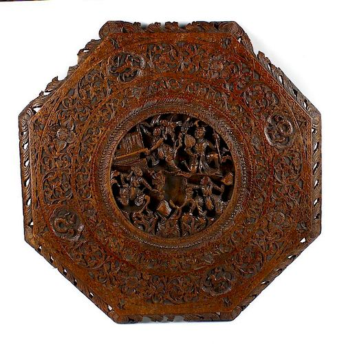 A 19th century Chinese carved wooden octagonal table top. The centre modelled in deep relief with fo