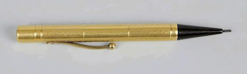 A Watermans 18ct gold propelling pencil, the cylindrical barrel with alternating plain and chequered