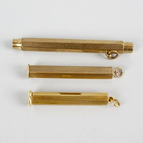 An 18ct gold cigar piercer, the hexagonal outer case enclosing cylindrical piercer and the whole wit