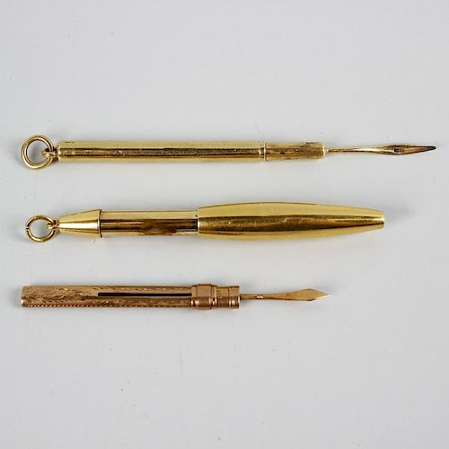 An 18ct gold retractable pencil of plain ovoid form, plus a toothpick within plain cylindrical outer