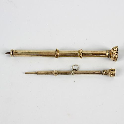 Two 19th century yellow metal propelling pencils. Each of facetted form with stone-set terminal, la