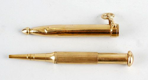 A Sampson Mordan & Co. 9ct gold propelling pencil, the ribbed barrel with domed terminal, within pro