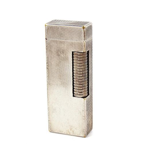 A Dunhill rollagas lighter, the rectangular shaped body with engine turned decoration, impressed Dun