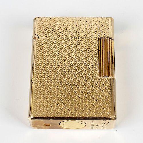 A Dupont gold-plated cigarette lighter. K3AJ87, of textured rectangular form, 1.75, (4.5cm) high. <b