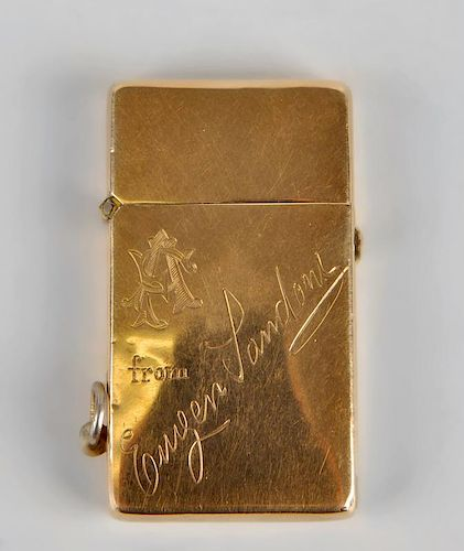 A 9ct gold lighter, of plain rectangular form having engraved monogram and dedication to front, mark