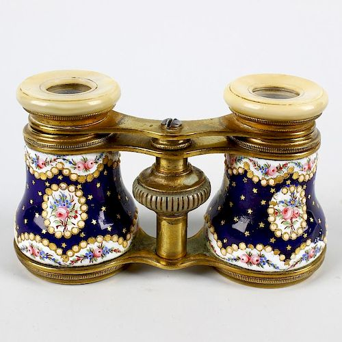 A good pair of French Palais Royal-type enamelled opera glasses. The mother of pearl eyepieces on ex