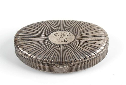 A Continental white metal oval snuff box Circa 1800, the fan-reeded hinged cover with oval cartouche
