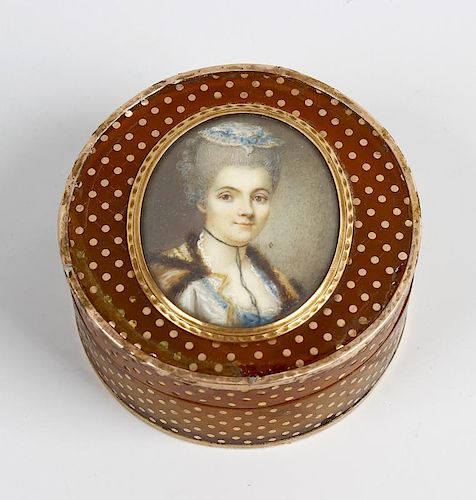 A 19th century French inlaid horn patch box The circular push-on cover centred by an oval portrait o