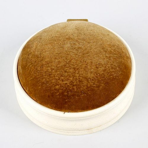 A 19th/early 20th century ivory dressing table box, with domed hinged pin cushion cover, enclosing a