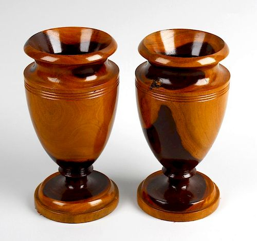 A pair of treen vases Each of neoclassical urn form, in turned laburnum, 7.5, (19cm) high, together