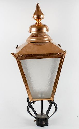 A reproduction copper lantern. The tiered spire finial over pyramidal top and tapering four sided bo