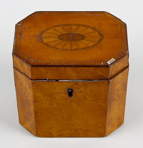 A George III inlaid satinwood tea caddy, of hinged canted oblong cover centred by a bat's wing pater