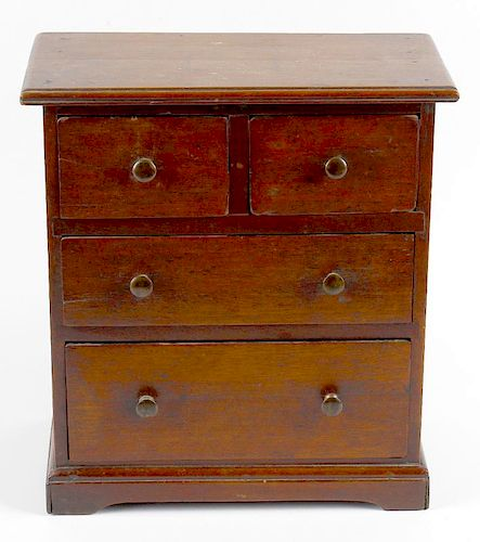 A 19th century mahogany miniature chest of drawers. Perhaps an apprentice piece, the rectangular top