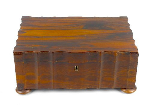 A 19th century Anglo-Indian coromandel sewing box South India/Sri Lanka (Ceylon) Of wavy oblong form