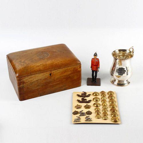 A collection of Warwickshire Regiment memorabilia. Comprising: a walnut humidor or cigar box, the do