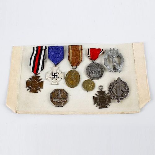A group of assorted German badges and medals. To include World War I and Third Reich examples, (9).