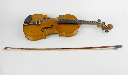 An early 20th century inlaid violin. The reverse having mother-of-pearl inlaid interlocking motif, a