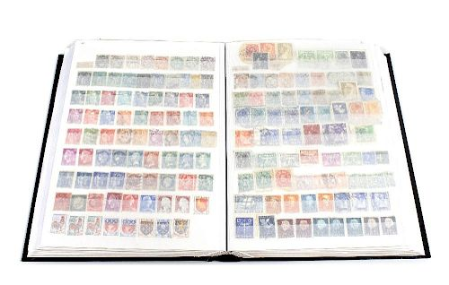 A large mixed album of stamps. To include early 20th century and Victorian examples, plus German, Sw
