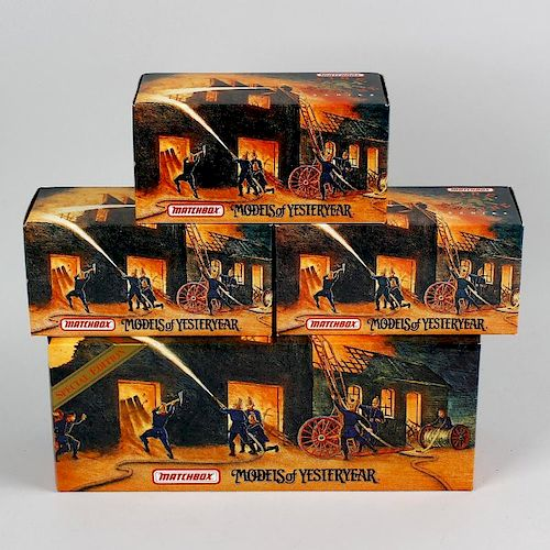 A box containing 20 Matchbox Models of Yesteryear diecast model Fire Engine series vehicles, each in