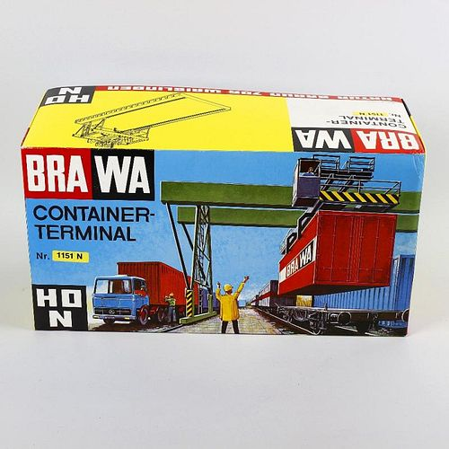 A box containing a mixed selection of Brawa, Pola and other H0/00 model railway plastic model buildi