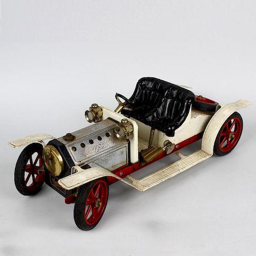 A box containing a Mamod ME1 live steam model marine engine in original box, a meccano live steam mo