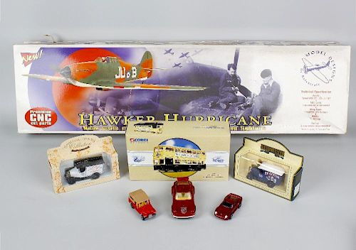 A box containing assorted toys and models. To include Balsacraft Hawker Hurricane, mechanical Hector