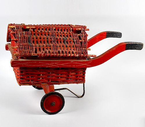 A 1930s GPO type toy cart. With red painted hinged cane and wicker roof, over conforming body and wo