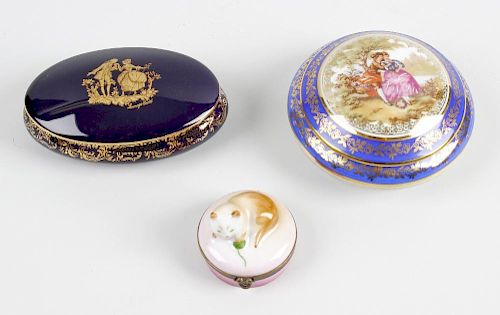 A box containing an assortment of modern porcelain and papier mache boxes. Together with a large qua