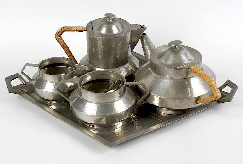 A box of assorted collectables. To include an Art Deco style hammered pewter five piece tea set, an