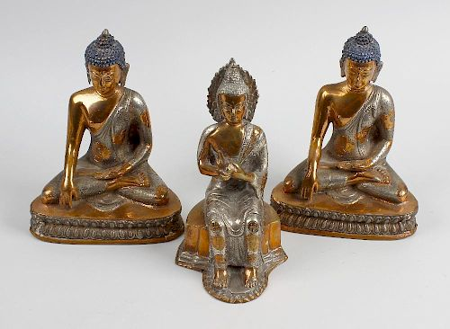 A box containing hollow cast copper and white metal figures, each modelled as an Eastern deity. <br>