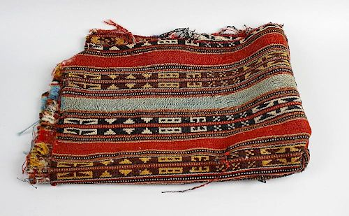 A box containing assorted textiles To including two brightly coloured small kelim rug fragments, and